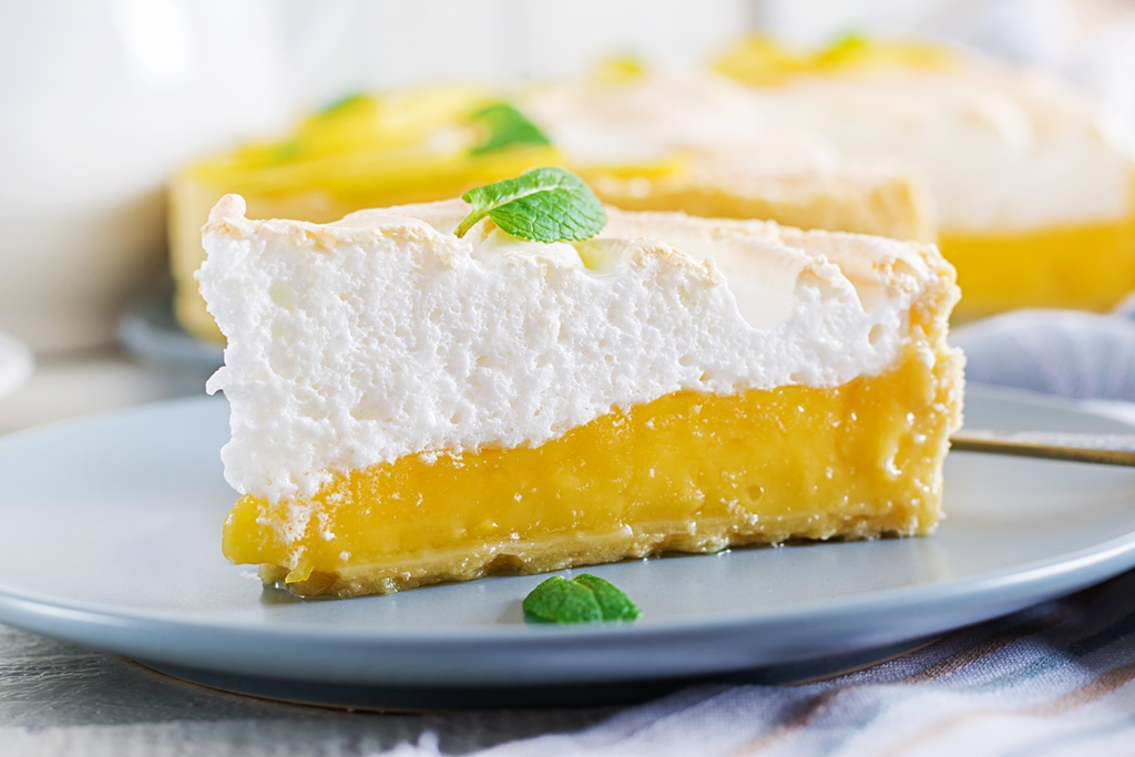 a slice of lemon meringue tart